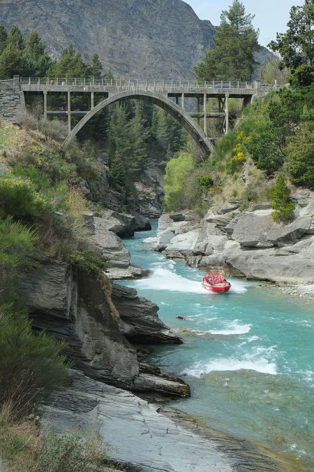 shotover_river_at_edith_cavell_bridge_at_arthurs_point_with_shotover_jet_boat_racing_up_the_river
