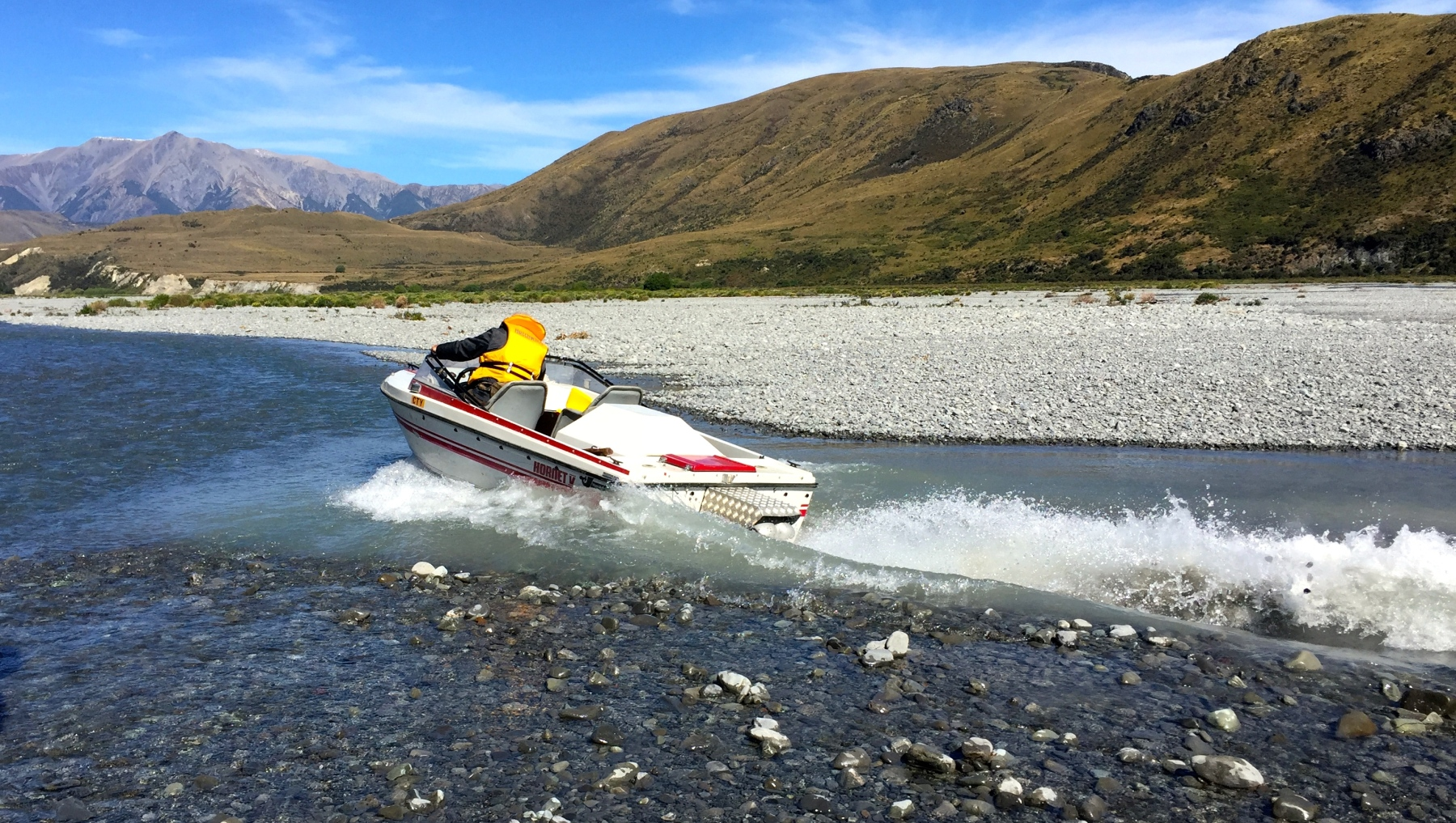 Wetlander Jet Boat going through rocky shallow water
