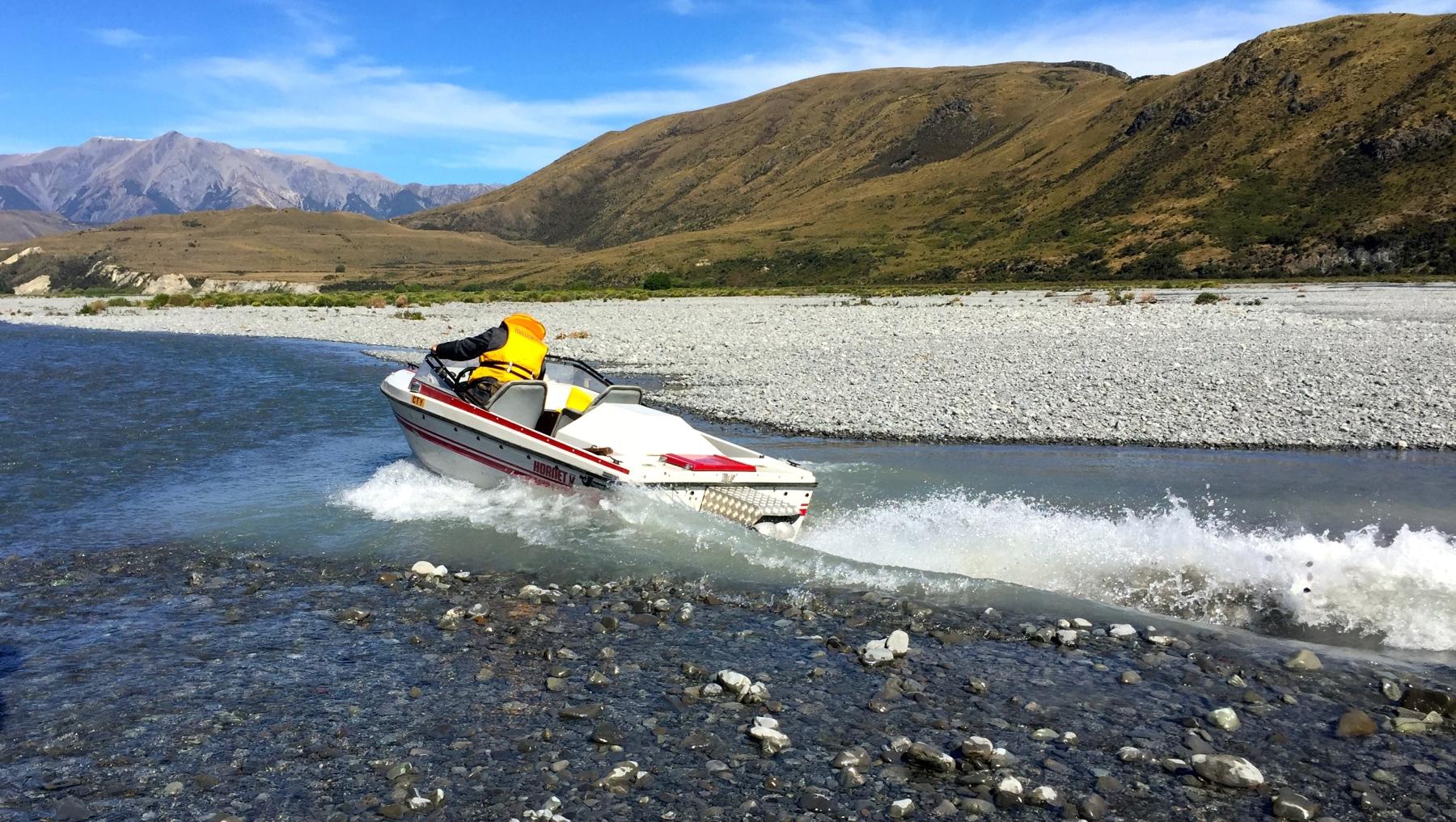 Wetlander Jet Boat going through rocky shallow water